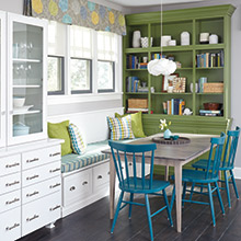 Daladier cabinets in white and green in a dining area