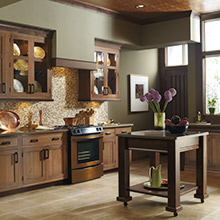 Harmony kitchen cabinets in a neutral brown stain