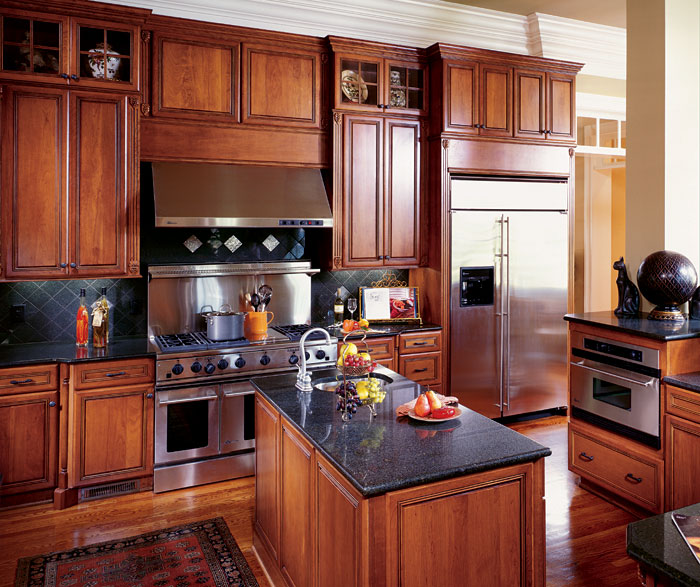 Kitchen with Cherry cabinets by Decora Cabinetry