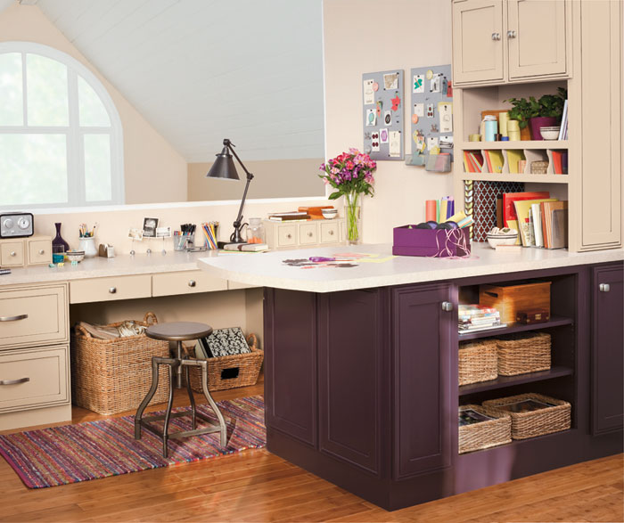 Home office with purple cabinets by Decora Cabinetry