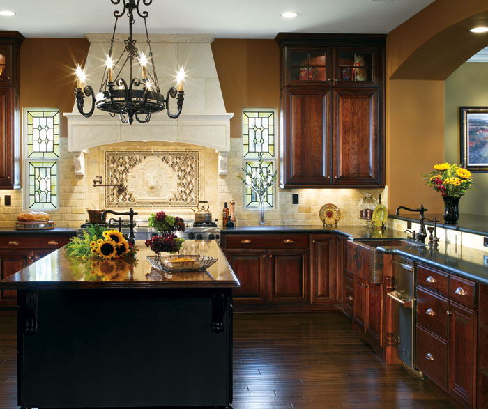 Dark Cherry cabinets in a traditional kitchen by Decora Cabinetry