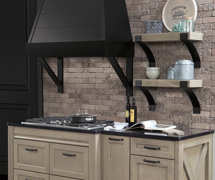 Rustic kitchen design with Tala Quartersawn Oak cabinets and black accents