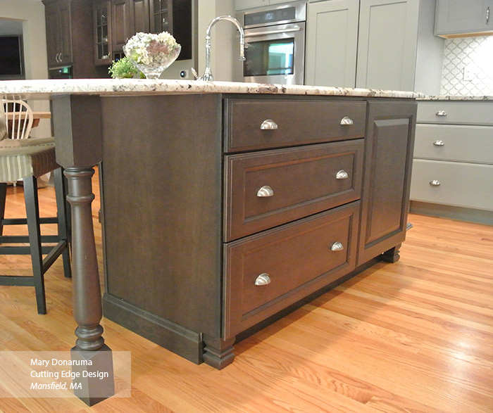 Close-up of dark Cherry kitchen island with the Maxwell cabinet door in Shadow finish