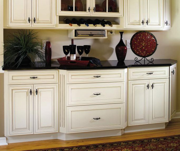 Off white cabinets by Decora Cabinetry