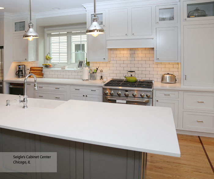 White Harmony inset cabinets with a gray kitchen island