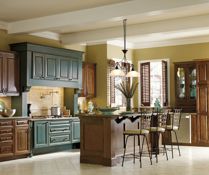 Cherry kitchen with turquoise cabinets by Decora Cabinetry