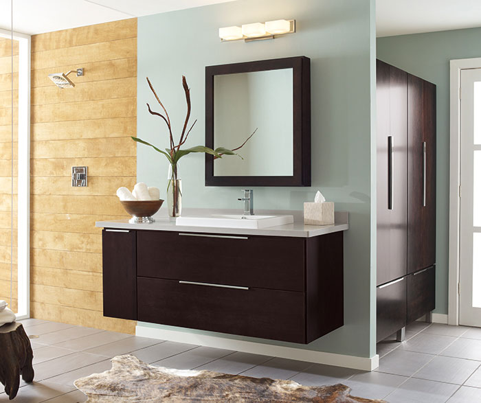 Wall-mounted bathroom vanity in dark Cherry by Decora Cabinetry